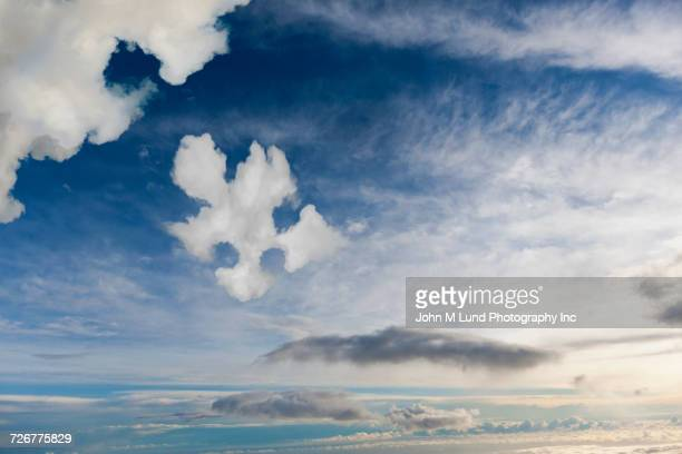 Cloud shaped like jigsaw puzzle piece in sky
