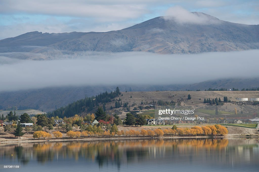 Cloud straddling mountain range and Lake Ruataniwha in the foreground