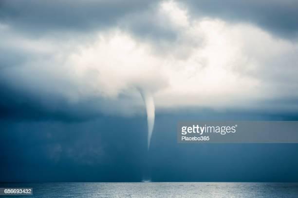 Cloud Typologies: Tornado, Hurricane, Cyclone, Typhoon, Cumulus Clouds in moody Sky during Sumer Monsoon Thunder Storm.