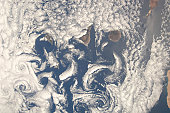 May 16, 2009 - A nadir view of cloud vortices in the area of the Canary Islands in the North Atlantic Ocean.