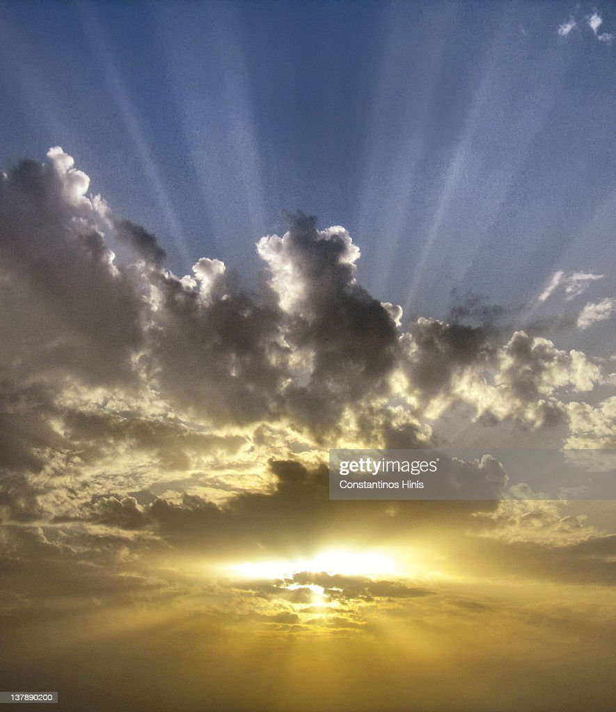 Clouds and rays : Stock Photo