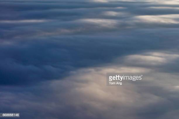 Clouds and reflection of sun on sea see from passenger plane.