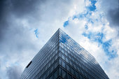 Clouds are reflected in the glass windows of an office building at Roche Holdings AG's plant in Rotkreuz Switzerland on Tuesday Aug 26 2014 Roche the...