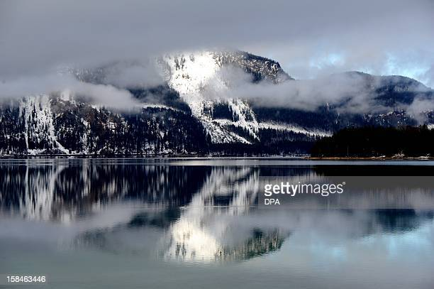 Clouds are reflected on the water of the Walchensee southern Germany on December 17 2012 AFP PHOTO / HARTMUT REEH /GERMANY OUT