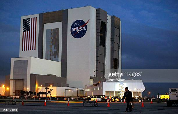 Clouds are seen behind the NASA's Vehicle Assembly Building at the Kennedy Space Center February 7 2008 at Cape Canaveral Florida Bad weather is...