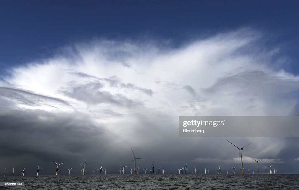 Clouds are seen forming over the wind turbines at the London Array project, the world's largest consented wind farm, a partnership between Dong Energy A/S, E.ON AG and Abu Dhabi-based Masdar in the Thames Estuary, U.K., on Wednesday, March 13, 2013. 'London Array will soon be the largest operational offshore wind farm in the world,' said Benj Sykes, head of Dong Energy's U.K. wind business. Photographer: Chris Ratcliffe/Bloomberg via Getty Images