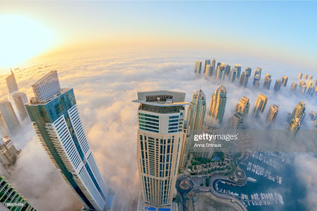 CONTENT] Clouds around tall buildings. Dubai. Early morning. May 2013.