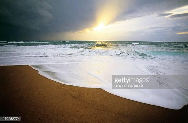 Clouds at sunset on the beach of Cirella on the Tyrrhenian coast Calabria region Italy