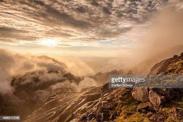 Clouds between the peaks of the Lofoten, Norway