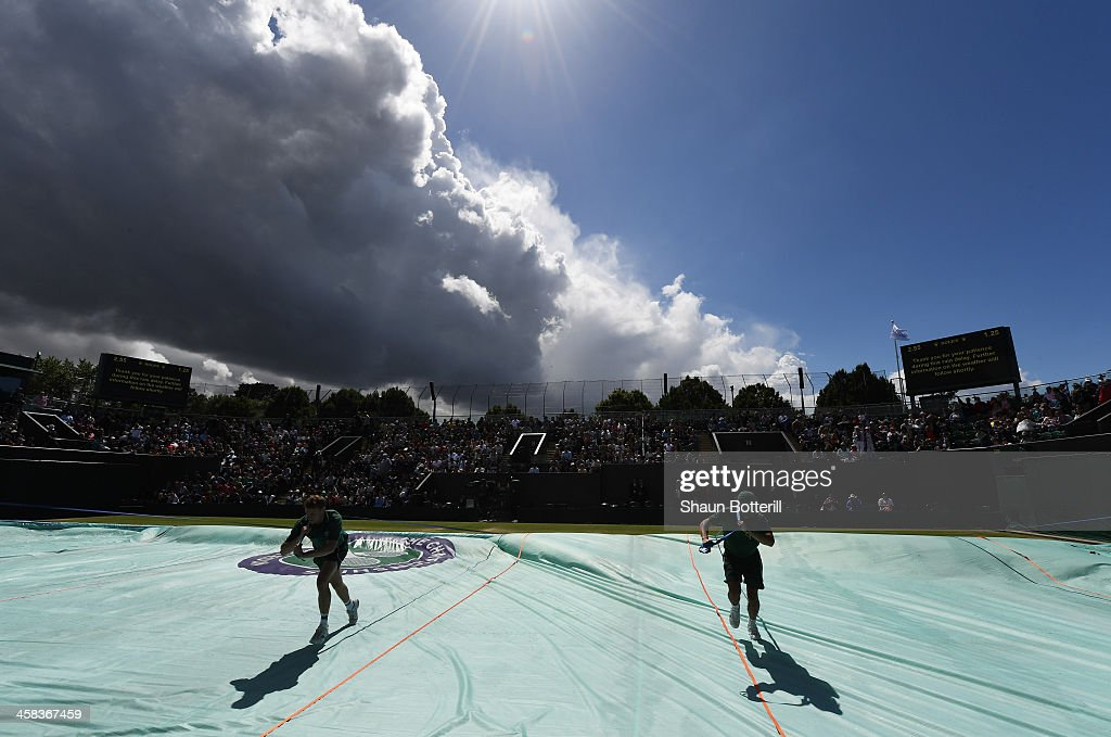 Clouds cover court three during a rain delay on day six of the Wimbledon Lawn Tennis Championships at the All England Lawn Tennis and Croquet Club on...