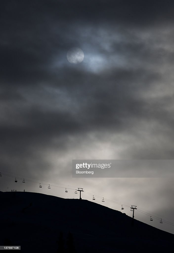 Clouds cover the sun above the Usser Isch chair lift on the ski slopes above the town of Davos, Switzerland, on Monday, Jan. 23, 2012. German Chancellor Angela Merkel will open this week's World Economic Forum in Davos, Switzerland, which will be attended by policy makers and business leaders including U.S. Treasury Secretary Timothy F. Geithner. Photographer: Scott Eells/Bloomberg via Getty Images