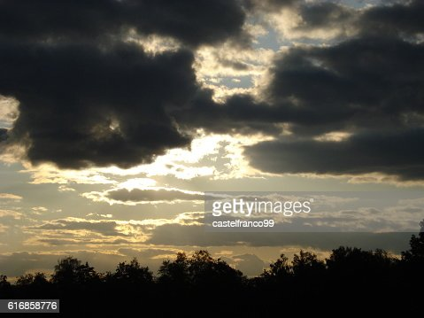 Clouds covering the sun in late afternoon : Stock Photo