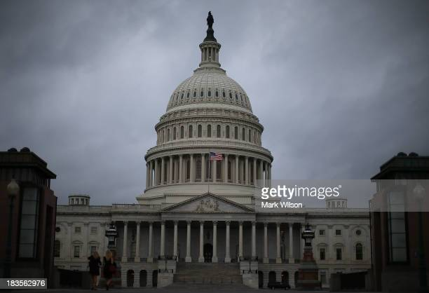 Clouds fill the sky in front of the US Capitol on October 7 2013 in Washington DC Democrats and Republicans are still at a stalemate on funding for...