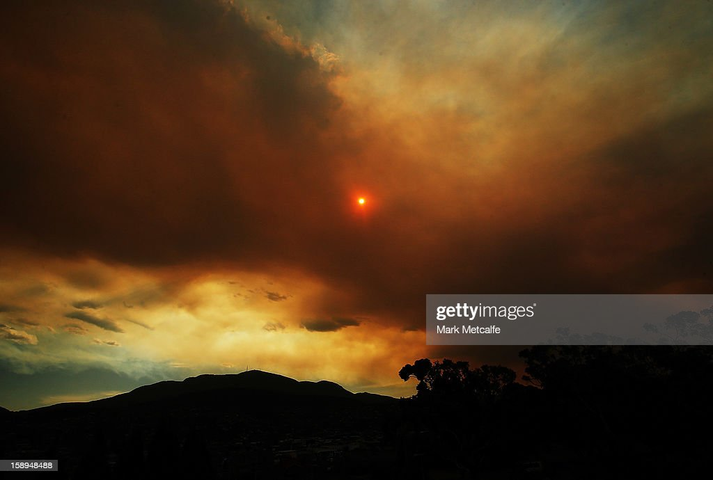 Clouds from a nearby bushfire are seen over Mount Wellington during day one of the Hobart International at Domain Tennis Centre on January 4, 2013 in Hobart, Australia.