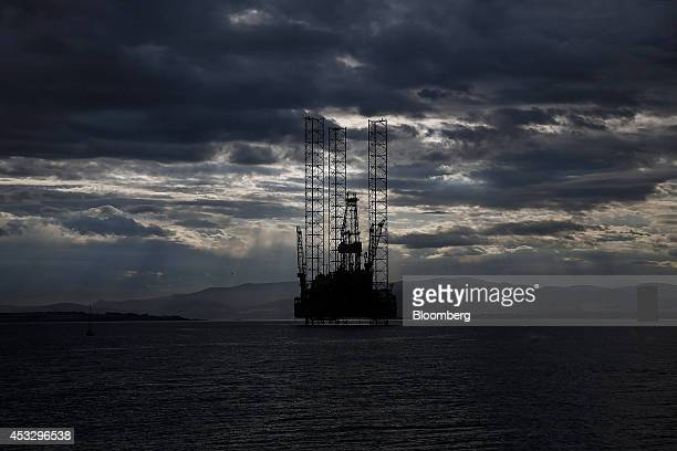 Clouds gather above offshore drilling rig Prospector 1 operated by Prospector Offshore Drilling SA as it stands anchored in the Cromarty Firth in...