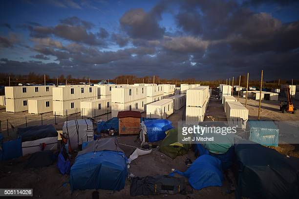 Clouds hover over a new migrant camp under construction near the camp known as 'The Jungle' on January 15 2016 in Calais France Thousands of migrants...