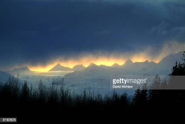 Clouds hover over snowy peaks near Prince Willam Sound on March 31 2004 near Valdez Alaska Fifteen years after the Exxon Valdez supertanker split...
