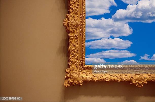 Clouds in frame in art gallery, close-up (Digital Composite)
