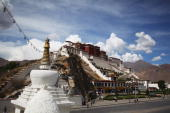Clouds move over the Potala Palace on June 19 2009 in Lhasa Tibet Autonomous Region China Traditionally Lhasa is the seat of the Dalai Lama the...