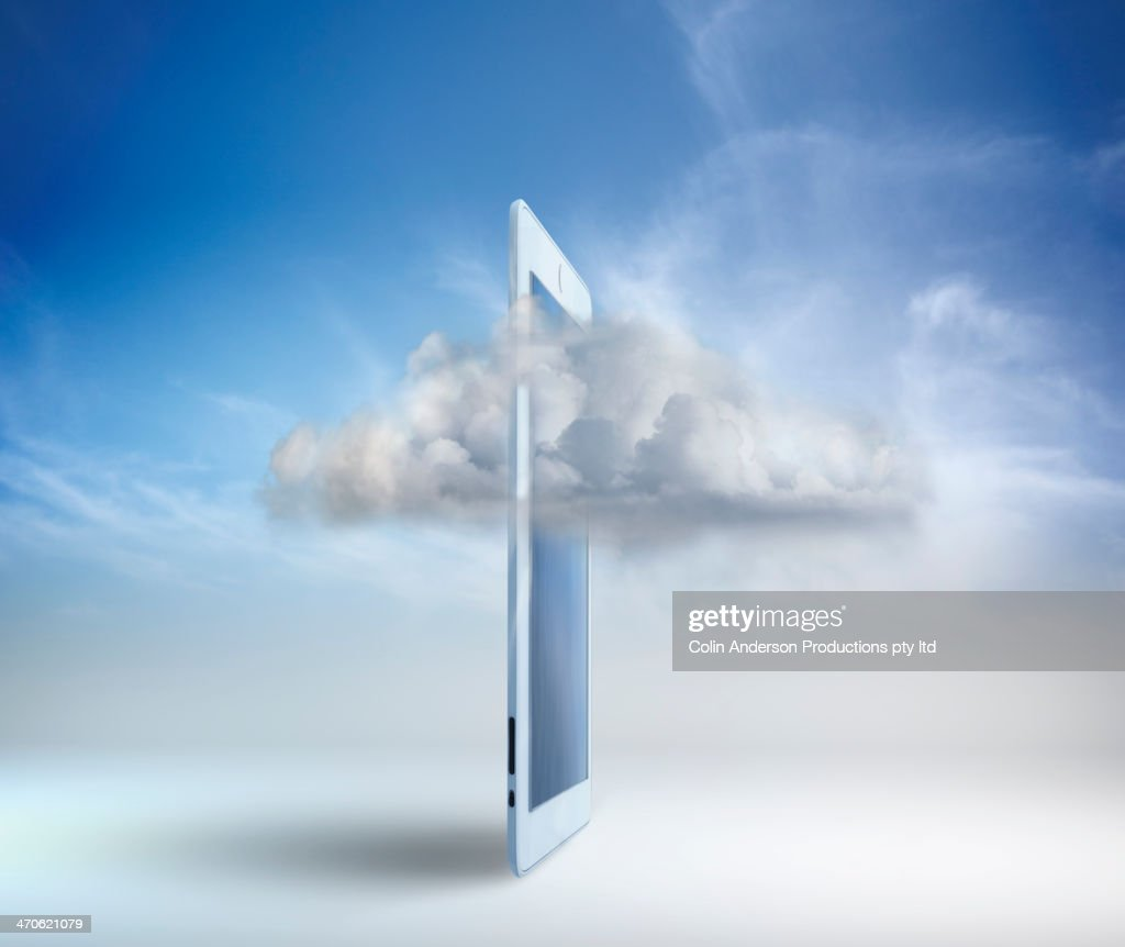 Clouds moving through digital tablet : Stock Photo