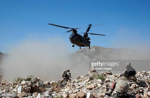 Clouds of dust kicked up by the rotor wash of a CH-47 Chinook helicopter in Afghanistan.