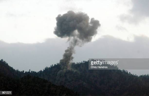 Clouds of smoke from USled bombing billow over AlQaeda positons December 14 2001 in the Tora Bora area of Afghanistan American and antiTaliban forces...