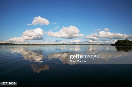 Clouds over a lake : Stock-Foto