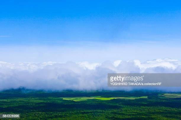 Clouds over grassland