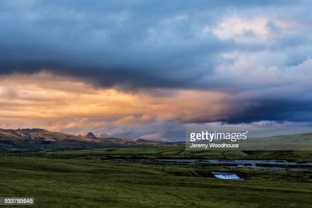 Clouds over green fields in rural landscape