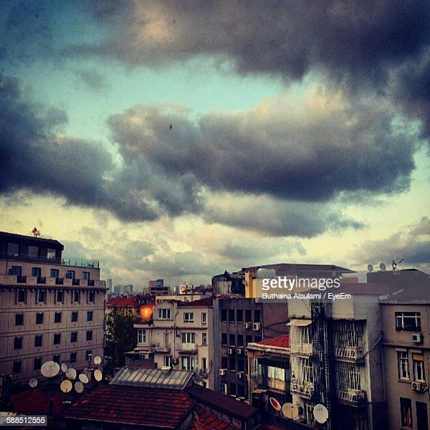 Clouds Over Houses And Buildings In City