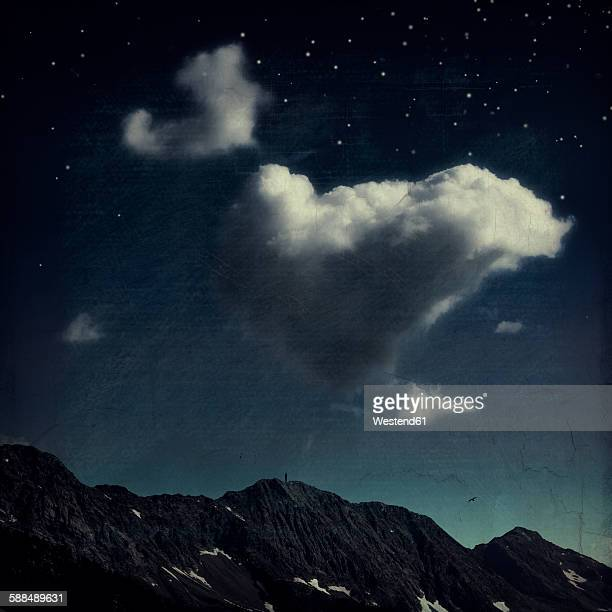 Clouds over mountain ridge, starry sky, digitally manipulated