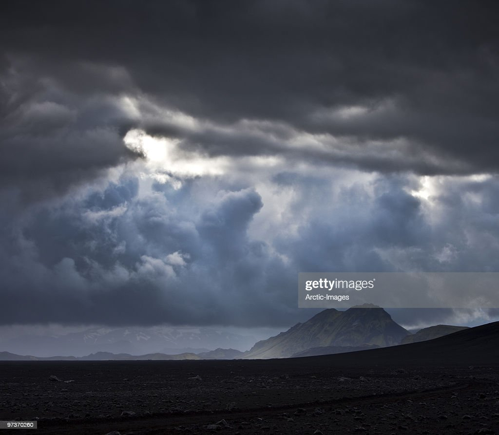 Clouds over mountains and black sands. : Stock Photo