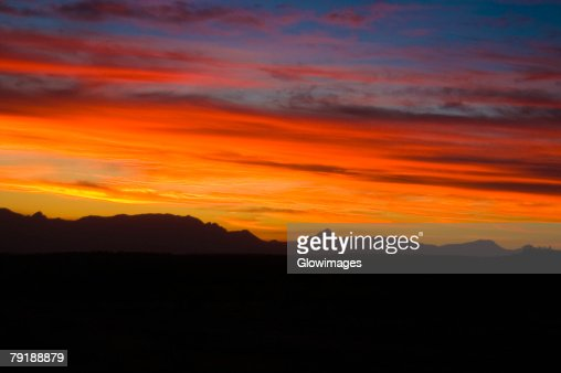 Clouds over mountains at sunset, Drakensberg, South Africa : Stock Photo