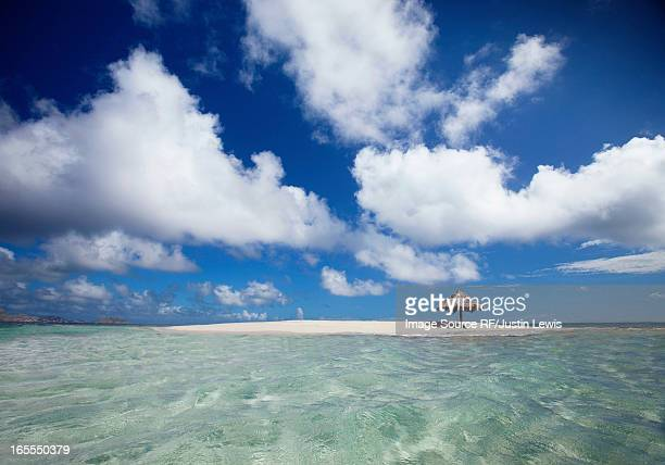 Clouds over sandbar and tropical water