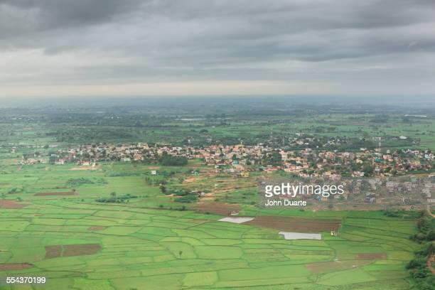 Clouds over village in rural landscape