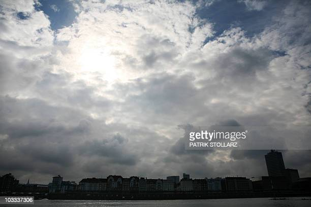 Clouds pass above the skyline of the western German city of Duesseldorf on August 5 2010 AFP PHOTO / PATRIK STOLLARZ