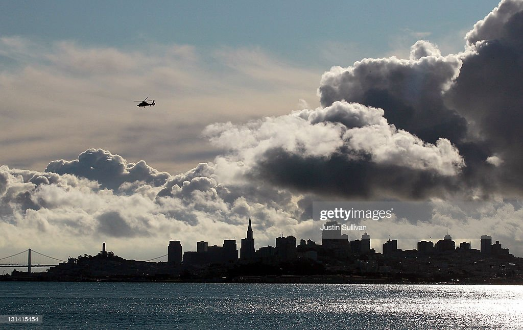 Clouds pass over the San Francisco skyline on November 4, 2011 in Sausalito, California. The San Francisco Bay Area will see mostly cloudy skies that will lead to a chance of showers in the afternoon. Daytime highs will reach into the upper 50s.