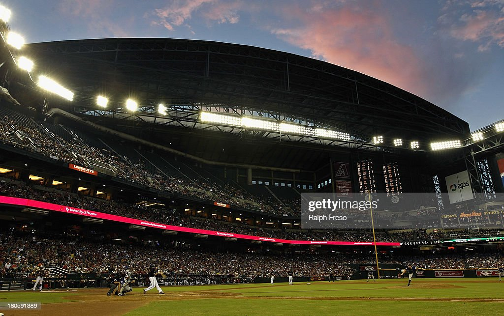 Clouds reflect the setting sun's light over Chase Field during a MLB game between the Colorado Rockies and Arizona Diamondbacks on September 14, 2013 in Phoenix, Arizona.
