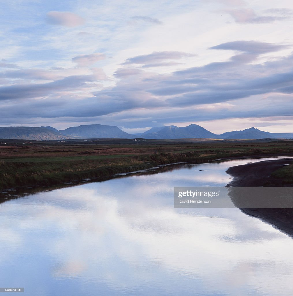 Clouds reflected in still river