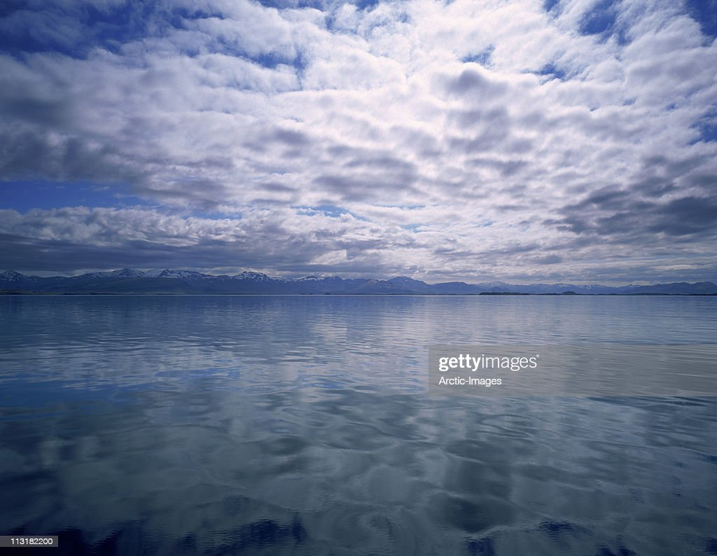 Clouds reflecting in fjord : Stock Photo