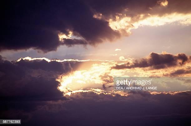 Clouds reflecting on the sea at sunset Aegina island Saronic gulf Piraeus Greece