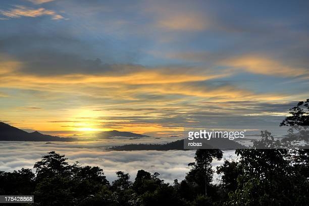 Clouds round mountains at sunset in Danum Valley