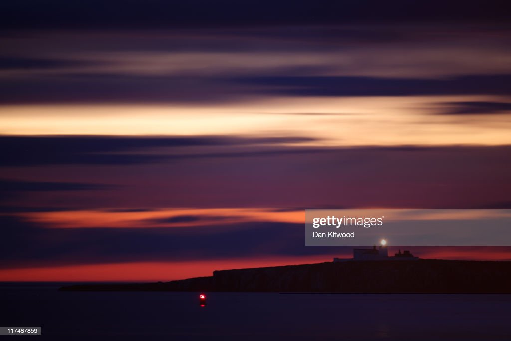 Clouds streak across the night sky over Inner Farn on June 25, 2011, on the Farne Islands, England. The Farne Islands, which are run by the National Trust, are situated two to three miles off the Northumberland coastline. The archipeligo of 16-28 separate islands (depending on the tide) make the summer home to approximately 100,000 pairs of breeding seabirds including around 36,000 Puffins, 32,000 Guillemots and 2,000 pairs of Arctic Terns. The species of birds which nest in internationally important numbers include Shag, Sandwich Tern and Arctic Tern. The coastline around The Farnes are also the breeding ground to one of Europe's largest Grey Seal colonies with around 4,000 adults giving birth to 1500 pups every year.