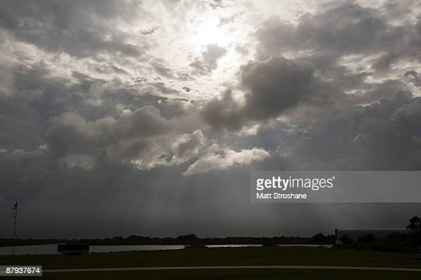 Clouds surround the NASA Press site and countdown clock at Kennedy Space Center on May 23 2009 in Cape Canaveral Florida Unfavorable weather...