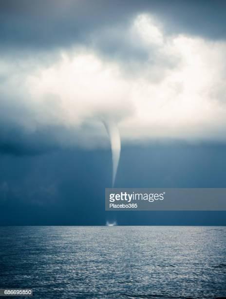 Clouds Typologies: Tornado, Hurricane, Cyclone, Typhoon, Cumulus Clouds in moody Sky during Sumer Monsoon Thunder Storm.