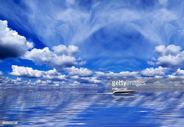 Clouds, water and a yacht