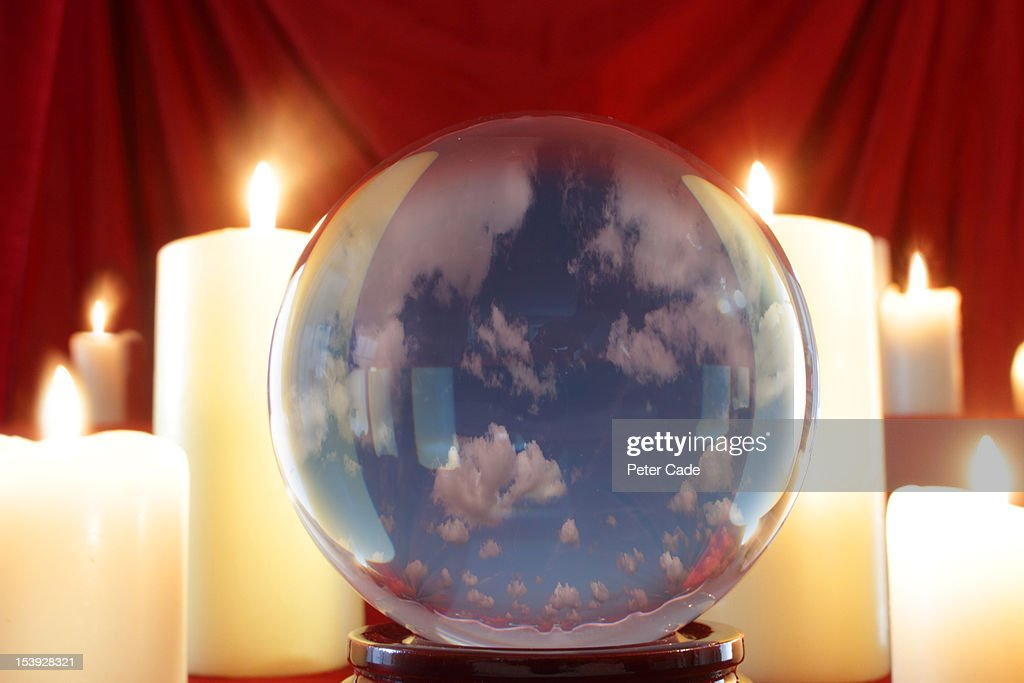 Clouds within crystal ball : Stock Photo