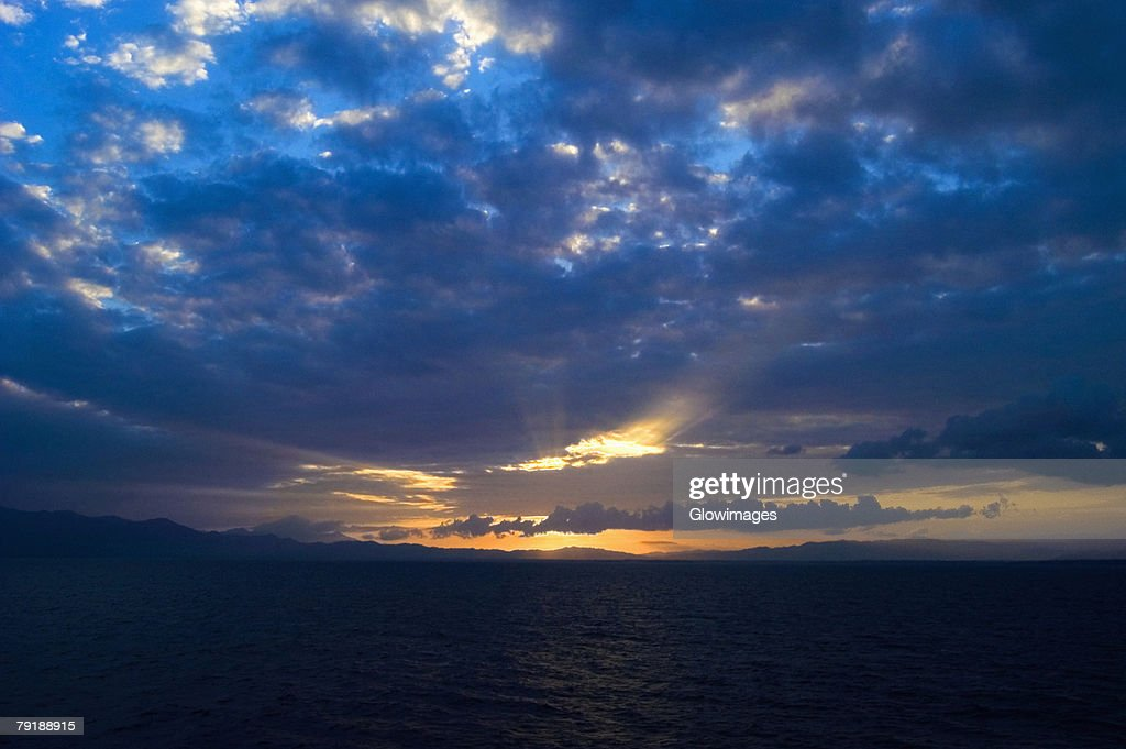 Cloudscape over the sea at dusk, Milne Bay, Papua New Guinea : Stock Photo