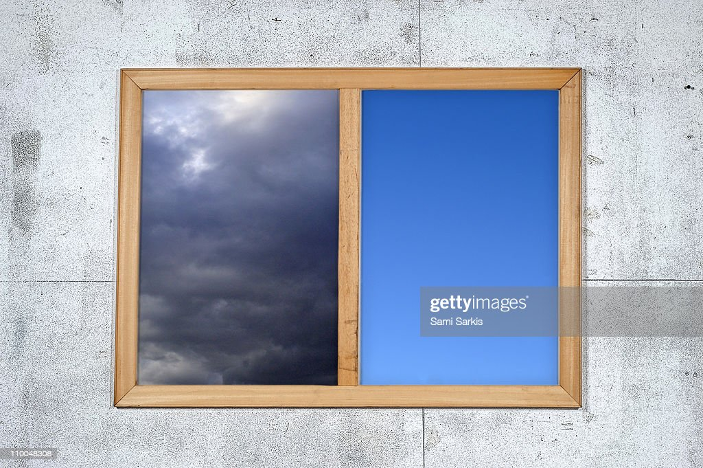 Cloudy and clear sky views framed, on white wall : Stock Photo