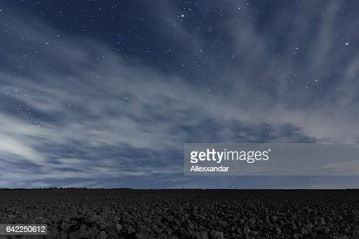 Cloudy Night sky with stars. Night background. Night sky. : Stock Photo